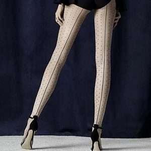 Nude and black polka dot tights with seams