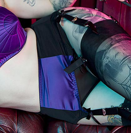 Retro style suspender belt in black with purple front panel
